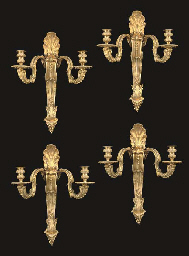 A SET OF FOUR REGENCE STYLE ORMOLU TWIN-LIGHT WALL-APPLIQUES