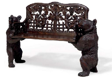 A SWISS 'BLACK FOREST' CARVED LINDEN WOOD BENCH