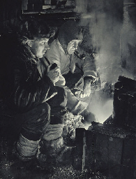 Meares and Oates at the blubber stove, 26 May, 1911; Capt. Scott writing up his Journal in the Winter Quarters Hut, 7 October, 1911