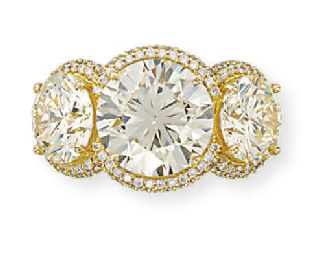 A THREE-STONE DIAMOND RING, BY