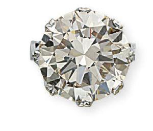 A SINGLE-STONE COLOURED DIAMON