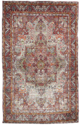 An antique Kirman carpet