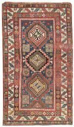 An antique Kazak rug