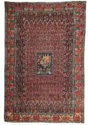An unusual antique Senneh rug