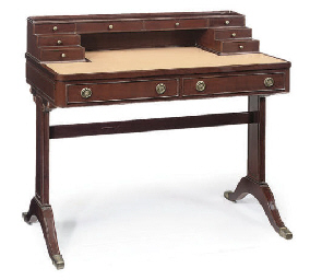 A GREEK MAHOGANY WRITING DESK
