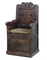 A FLEMISH CARVED OAK BOX SEAT