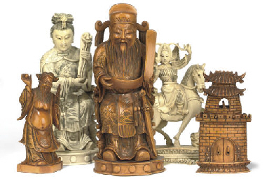 A CHINESE CARVED IVORY FIGURAL