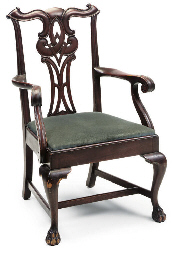 A LARGE MAHOGANY ARMCHAIR