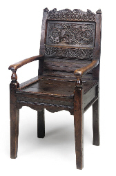 AN OAK ARMCHAIR
