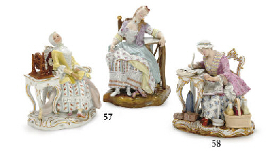 A MEISSEN FIGURE OF A SEATED W