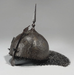 A QAJAR CARVED STEEL HELMET, I