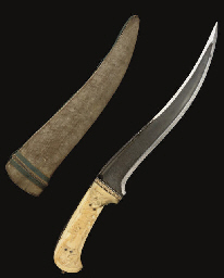 A CARVED IVORY HILTED DAGGER,