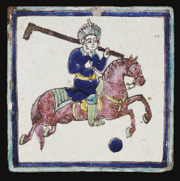 A QAJAR TILE WITH POLO PLAYER,