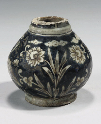 A SAFAVID POTTERY BOTTLE BASE,