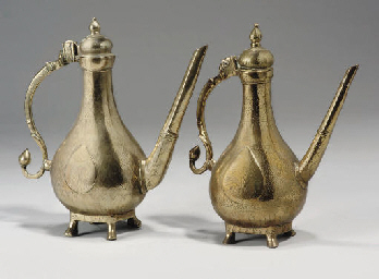 A PAIR OF MUGHAL BRASS EWERS,