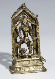 A BRASS FIGURE OF MAHISHASURAM