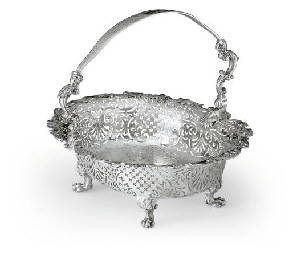 A GEORGE II IRISH SILVER CAKE