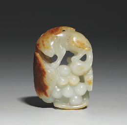 A WHITE AND RUSSET JADE CARVIN