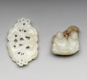 A JADE CARVING OF TWO FIGURES;