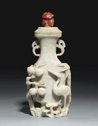 AN OPAQUE WHITE JADE VASE AND