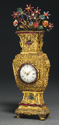 A GILT METAL TIMEPIECE
