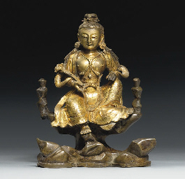 A GILT BRONZE SEATED BODHISATT