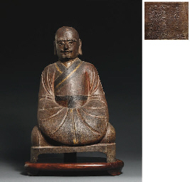 A MING CAST IRON FIGURE OF A L