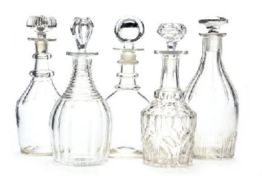 FIVE CLEAR GLASS DECANTERS AND