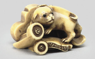 An ivory netsuke of a puppy, 1