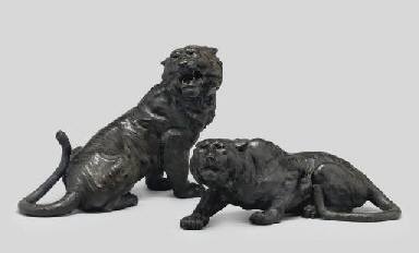 A Pair of bronze models of tig