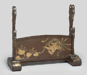 A gilt lacquered sword stand,