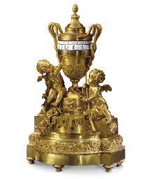 A LOUIS XVI STYLE ORMOLU MANTE