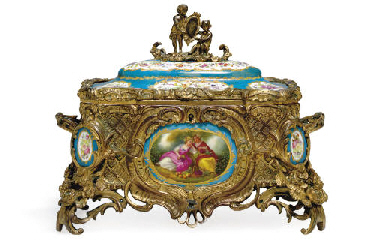 A GILT-METAL PORCELAIN-MOUNTED