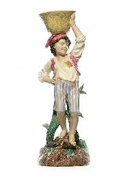 A FRENCH MAJOLICA FIGURAL JARD