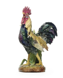 A FRENCH MAJOLICA MODEL OF A C