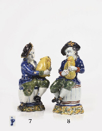 A Dutch Delft polychrome figur