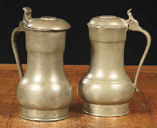 Two Dutch pewter flagons,