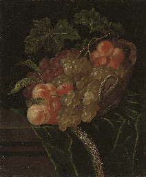 A pomegranate, apricots, grape
