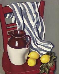Cruche et citrons sur une chai