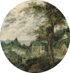 A river landscape with a town,