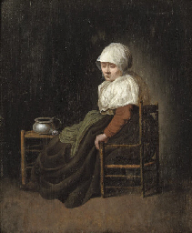 A woman seated in a chair by a