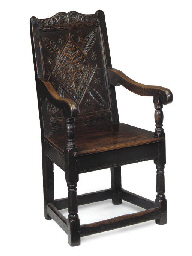 A GLOUCESTERSHIRE OAK ARMCHAIR