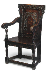 AN ENGLISH OAK ARMCHAIR