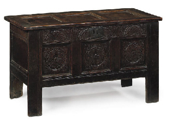 AN ENGLISH OAK PANELLED CHEST
