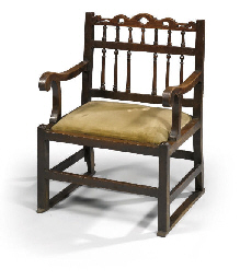 A GEORGE III WALNUT ARMCHAIR