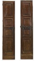 A PAIR OF ITALIAN WALNUT DOORS
