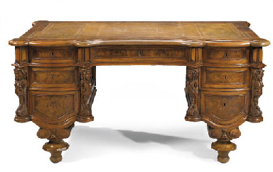 A GERMAN WALNUT KNEEHOLE DESK