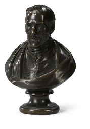 A BRONZE BUST OF A GENTLEMAN