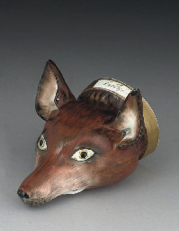 A STAFFORDSHIRE PORCELAIN FOX-