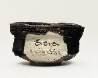 A black Oribe chawan [tea bowl